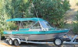 1998-22 ft Alumaweld ---- Open Bow Walk-Thru Windshield 2-Front Guide Seats & two Rear Bench Seats on Long Storage Box's Heater-Defrosters Humminbird Fishfinder & VHF Full Folding Top w/Side curtains & Back Drop Rear Camper Cover 351ci/240hp FWC Ford
