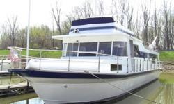 Custom made 1976 Pluckebaum houseboat, 65 x 18, all update done in 2008, master bedroom with full bathroom, queen size bed, inside helm, queen size pull out couch, twin pullout couch, kitchen, dining area, dish washer, garbage disposal, residential