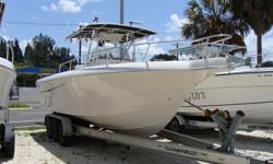 T-Top, Twin 200hp Johnson Ocean Runners, Great Shape, Full electronics package, Large center console-room for porta potti, Livewells, Fishbox, Full Cushions, Includes tandem aluminum trailer.