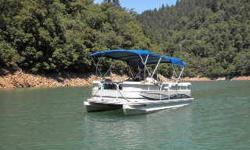 This is a Crestliner Pontoon Boat the model is 2185 Bata Bay. It comes with a double axel galvanized trailer and a 75 horse Mercury motor with 103 hours. It has a double bimini, upgraded captains chair, depth finder, table, with lots of seating and plenty