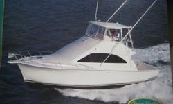 Low hours with one new engine and a year warranty on it. One of Ocean's most popular Sport Fish models to date. This two stateroom sport fish has it all. Full salon with a four person dinette, large sofa, and galley up, a master stateroom with 7'