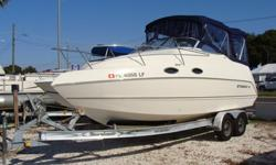 5.0 Mercruiser with 200 hours, Full Camper enclosure, full galley-frig, stove, sink. Enclosed head with holding tank, V-berth forward, Queen aft. 2005 Aluminum Drive-on Trailer with heavy duty axles and wheels. This boat is in very good condition and