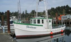 1933 classic wood double ender, built by Wilson Brothers, Bellingham, Washington, completeley rebuilt below and above the water line, deck area; interior spaces recently totally refinished. Fully equipped salmon/tuna troller with trolling gear and one ton