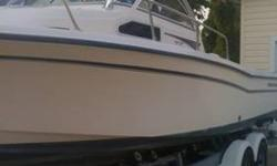 2001 Grady White Seafarer 226. Powered by 1999 Evinrude 225 2 stroke, very low hours, below 400. New computer and lower end in 2010. Boat is detailed and ready to go. New tires and brakes on trailer. Brand new custom hardtop with deck lights and pole