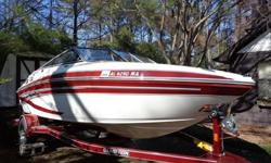 This Alabama crimson red and white 2009 Glastron GLS 195 bowrider features a 220 Hp 5.0 Mercruiser engine, bow cover, cockpit cover, bimini top, snap-in carpets, AM/FM/CD Sirius satellite-ready stereo w/4 speakers & MP3 adaptor, drink holders, grab