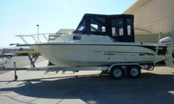 24' Walk Around Cuddy Cabin, 250 Evinrude Ficht Ram Injection 2-Stroke Very Low Emission Sticker, Driver And Passenger Captain Seats With 2 Rear Jump Seats And 2 Rear Facing Seats, Rocket Launchers, Pole Holders, Compass, Humminbird Piranha Max 215 Fish