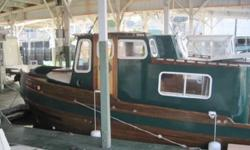 This boat is a Custom built Hankinson Design Pilothouse Tug. Over $35,000.00 refurbishing work done on her this year. Two 50 HP 2005 Mercury Mercury motors with low hours. Fresh bottom paint and hull paint 10-13. Beautifully sculptured bow and sculptured