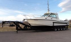 This 2008 Boston Whaler 345 Conquest has never been in Salt Water and only has 60 hours on the motor. The power put out by the 3 Mercury Verado 250XL's is very impressive. You will be able to find your way anywhere with 2-Raymarine E-120 GPS/Chartplotter