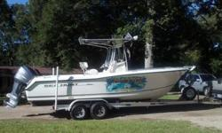 2006 23 FOOT TRITON SEAHUNT WITH YAMAHA F-250 4-STROKE TANDEM AXLE TRAILER PRICED FOR QUICK SALE AT $27,500 LOWRANCE GPS, FISH FINDER, VHS, AM/FM STEREO CD, LARGE OVAL LIVE WELL, 2 INSULATED FISH BOXES, T-TOP WITH T-BAG, NEW REMOTE CONTROL SPOTLIGHT,