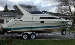 This boat has been well maintained and includes a newer tandem axel EZ Loader Trailer. It is equipped with newer snap in carpets, new is-sn glass and canvas, two 6 volt house batteries, 12 volt starter battery and a automatic isolator switch, as well as