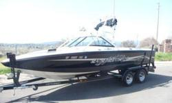 2003 Centurion Avalanche; Storm Series package,; 22 feet in length, eight feet width; walk through transom (I LOVED this, it makes it easier to load and unload people); open bow with cushion insert; snap in removable carpet; 315 horsepower, 5.7 litre