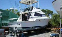 fiberglass hull with Twin 454 Crusaders, Water tank holds 30 gallons, Gas tank holds 300 gallons Walk in salon, walk down galley, bunk beds, full head with stand up shower, master v-berth, with air conditioning and generator, Full tower with outriggers,