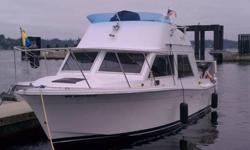 Here is a classic Uniflite Flybridge with all the comforts of home. Easy access through transom door off swimstep. Nice 8' Sorenson hanging off stern, room to fish or entertain, twins and flybridge for great control. Inside warm and comfy, Ick factor