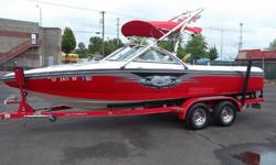 Lightning has hit you. This beautiful boat with perfect pass, ballast, high swoop back stainless tower with factory wake board racks will knock you off your feet. Has Centurions Bling package. C4 wrap around seating for 10. Great performance with factory