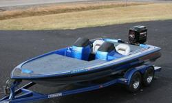 1994 Skeeter 20 foot bass boat. Powered by a 1995 2.5L 200 HP electronic fuel injected Mercury outboard.