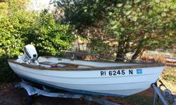 12' Amesbury Dory Boat made by Stur-Dee Boat Co. of Rhode Island. Includes 9.9 motor in great working condition, trailer, traditional rowing oars & oarlocks, boat cover.