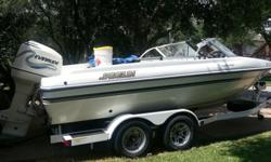 ,.,,,2000 Javelin Fish / Ski boat ..this boat is very rare come equipt with three live well , evinrude troller motor , fish finder and 200 hp Evinrude fitch ram fuel injected motor..the motor alone use will cost well over 4000 on ebay...boat also come