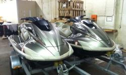 Selling both jet skis along with covers and 2010 Roadking trailer as a package.JET SKIS AND TRAILER ARE IN EXCELLENT CONDITION. Both skis are identical in color, with a Eclipse Black/Bronze Metallic finish. I am the original owner since 2010. One ski has