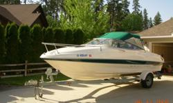 This boat is in great condition and offered at a price for a quick sale. The boat is White w Aqua Green Trim. It comes with an EZ Loader Trailer in great shape w great tires and fenders. The seats, carpet and trim are in excellent condition and can seat 6