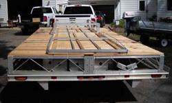 new 2013 VIBO aluminum roll in dock ,never pre-owned ,never installed ,4' wide ,40' overall length with additional 8' section to make 8x8 platform on end ,removable cedar decking assembled in 4x4 sections ,complete with plastic tires ,posts ,winches