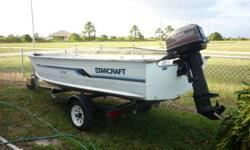 """1992 Starcraft 14 Ft Aluminum Boat - Tracker Trailer & Motor Has 20 Hp Johnson also has """" Anchor Mate """" Anchor Oars Life Jackets Can Hear Run !!! Boat - Motor & Trailer are in Very Good Condition.. Excellent boat for Back Waters or Shallows Asking Only"""