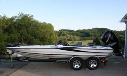 It has a Mecury Verado 250 four stroke. It is a dual console, with a hot foot, jack plate, and trim on the wheel. Comes with the dual axle lighted trailer with new goodyear tires, (less that 500 miles). Comes with three finders, two in the pics and the