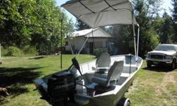 """25 hp Merc (recent tuneup) ,32 lb thrust Minkota Electric Motor. Great boat, economical, side trays and tray by motor to put """"stuff"""". Easy Load Trailer, three non-slip trailer walkplates; ; new tires (which just cost me $200.00); bearing buddies new"""