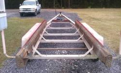 It measures 33' length overall and is designed for a larger 28' - 30' boat. It is a Triple Axle Aluminum Trailer and has brakes on the front axle. There is no winch or jackstand, however I am looking into putting 1 of each on this morning. This posting