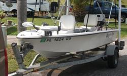 14'fiberglass flats boat w/ 30 HP Nissan outboardTrailer w/ tail light guide posts(Pipe-light.com)Stick steeringElectric tilt for motorBow mounted 'remote control' Minn Kota 55# trust trolling motorNew Bimini top with home made PVC supportsEagle fish/dept