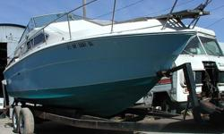 We will re-configure this 12,000 lbs capacity trailer to fit your powerboat for $ 2,500 including a pair of 6,000 lbs capacity axles, fenders, winch post, new carpeted support beams, and a new tongue jack. The boat on the trailer is a Sea Ray 260