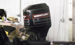 """Have a nice twenty """" shaft Mercury 115 horsepower two stroke with a stainless propeller, motor has tilt and trim is in exceptional shape, compression test showed 127 pounds per cylinder on all 4 cylinders, would make someone a very nice motor, new motor"""