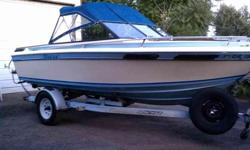 1980 SunRunner Sabre 18 1/two feet OMC in/out board, 350 V8 260+horsepower, hydraulic trim tabs, full top, Ez-Loader trailer. This is a very sturdy well built boat that was considered by some as top of the line for hull design and quality of construction.
