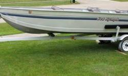 Aluminum V-Hull fishing boat with three seats. Includes Trailer with new stand. Stored indoors for the past eight years. Great condition. No leaks. Evinrude 9.9 outboard. Included Extras