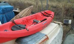 Ocean Kayak Scrambler II Covered storage cubbiesStrap down for cooler or ???Paddle included303 973 7899Listing originally posted at http