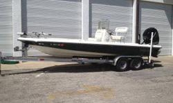 She is powered by a Mercury 250 hp Verado 4 stroke engine. Has been garage kept, great condition. Bimini Top, MinnKota 24v trolling motor, Power Pole anchor system, Lowrance LMS-332c gps/sonar, 3 bank onboard battery charger, livewell,stereo,Bobs jack