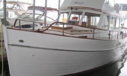 1969 Grand Banks 32 with lots of extras, such as spare anchor and prop, BBQ, chart plotter, VHS radio with DSC and AIS, Flat screen TV, inverter, and Blue tooth stereo with speakers up and down. The boat has most of the exterior painted as well as the