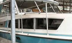 A classic Tollycraft 34' with Flybridge. Twin chrysler 360's, smim step, full galley, head with separate shower, privacy berth forward. Bobbing in covered slip in Kingston ready for it's new owner to take charge. Great family boat, 3 bouble berths, aft