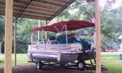 2006 Bentley 240 Fish with trailer24' pontoon boat with 115hp Mercury two-stroke engine and tandem axle trailer. This boat is in excellent condition. The interior, carpet, and all vinyl are spotless with no rips or tears. Boat has a front fishing deck