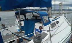 This is a racing hull with cruising accommodations. Virtually the whole interior has been paneled with wood. She is ready to race or cruise with 11 sails and lots of winches on deck. She has a full cockpit cover from dodger to transom, autopilot, dinghy,