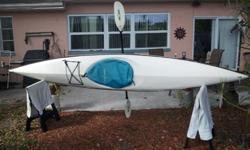 Kayak for sale, light weight and strong FG/Gelcoat kayak 13.2 ft. comes with Aqua Round Kayak paddle and Wilderness System Canvas seating cover and floatation cells. Has tie down for light storage.One person and easily pick this kayak up and move it