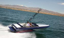 1997 22' Howard Custom Inboard Boat with closed bow. Seats 5 has 454 motor with blower by Teague Racing. Has a Bravo 1 outdrive, sony marine radio, trim tabs, swim ladder, full boat cover, matching Ellis tandem trailer. 302 motor hours.