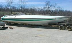 This beautiful boat is 10' wide and it is so deep that when you stand up, your head barely goes out the big double-cabin hatch. The outer hull is in GREAT shape, but the interior needs new carpet and new upholstery. There are NO engines and NO outdrives,