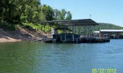 New private single stall boat dock with permit on Norfork Lake. 10'x28' boat stall, 10'x20' swim platform, storage locker, fish cleaning station with pump.With2005 Landau 24' Bandit pontoon with 70hp 4-stroke Suzuki motor with very low hrs. East of