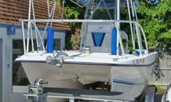 "Powered With Twin 140 H.P. Suzuki (4-Stroke) Outboard Motors With Low Hours, T-Top With Forward Bimini Top, Raymarine E-120 GPS, Radar, VHF, Anchor Windlass, Trim Tabs With Trolling Motors, Battery Charger, Porta Potti, ""NO TRAILER"", This Boat Is In"