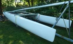 This Nacra is in great condition. The hulls were recently removed from the cross braces and repainted and the trampoline was replaced, the standing rigging has been replaced and improvements were made to the steering and rudder system. The sails; however,