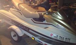 The wave runner is a 1998 Bombardier Sea-Doo GTX-RFI. The engine is a 787 with a stroke of 74 and the displacement is 781.6. It only has 133 hours on it. A cover and trailer come with it. The wave runner is about 10 feet and seats 3. It has mirrors and is