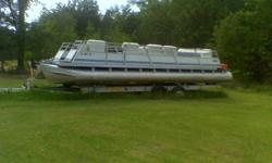 1972 Starlighter twin alumne 28' pontoon boat with 70 hp Evenrude and commercial trailer with new tires.