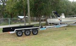 26-28' Boat. this is Owens & Sons slide on with torsion axle ss brakes, tires very good.