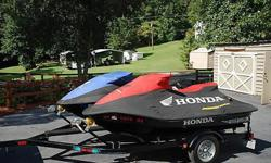 2005 Honda Jet Ski's personal watercraft.Cover for each ski.Both adult ridden.Never been in salt water.Like new condition.Approximately 75 hrs on each ski.Double comfab painted trailer.Two extremely nice ski's.