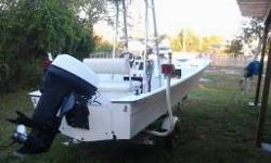 Fully working flat and intercostall boat. Great for red fishing or crusing the water. Has 2 live wells, humingbird fish finder, cooler seat, seat on the center consol front and a captin seat on the bow. Seat 5 - 6 easily. Storage in the bow for ancor